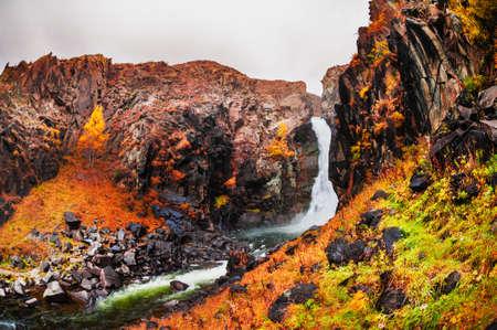 Kurkure waterfall in Altai mountains, Siberia, Russia. Beautiful autumn landscape Reklamní fotografie