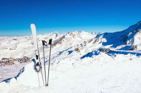 Winter ski resort in Alps mountains. Ski equipment in the snow on the slope.