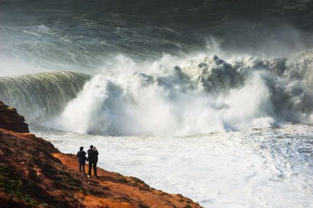 Big waves on the coast of Atlantic ocean in Nazare, Portugal. In this place the biggest waves in the world due to the underwater canyon