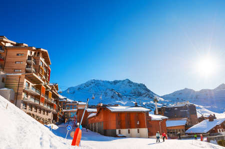 Winter ski resort in Alps. Val Thorens village, 3 Valleys ski resort, France. Beautiful mountains and the blue sky
