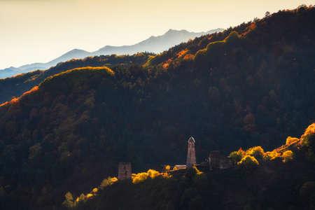Old stone tower complex in Erzi national park in Ingushetia, Caucasus, Russia. Beautiful autumn landscape at sunrise. Stock fotó
