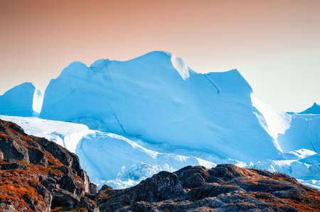 Big blue icebergs in Ilulissat icefjord at sunset, western Greenland. Summer landscape Zdjęcie Seryjne