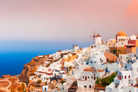 Beautiful sunset at Santorini island, Greece. Panoramic view of Oia town. Summer landscape, sea view. Famous travel destination Zdjęcie Seryjne
