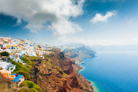 Panoramic view of on Santorini island, Greece. Summer landscape, sea view. Blue sky with clouds over the island. Famous travel destination Zdjęcie Seryjne
