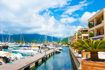 Yachts in sea port of Tivat, Montenegro. Kotor bay, Adriatic sea. Famous travel destination. Beautiful summer landscape