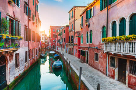Beautiful canal with old medieval architecture in Venice, Italy. Famous travel destination