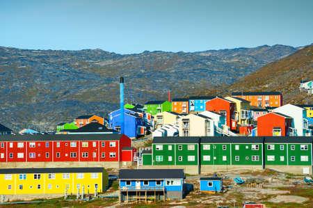 Colorful houses on the rocks in Ilulissat, western Greenland. Summer landscape Zdjęcie Seryjne