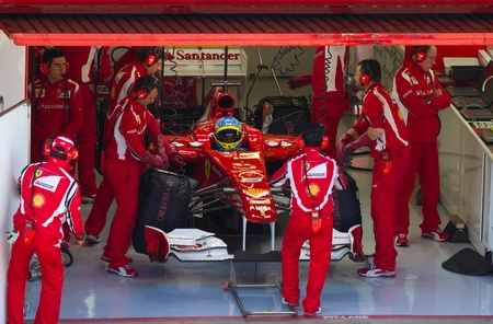 BARCELONA, SPAIN - FEBRUARY 18, 2011: Fernando Alonso of Ferrari in the pits during Formula One Teams Test Days at Catalunya circuit. 에디토리얼
