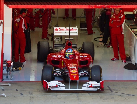 pits: BARCELONA, SPAIN - FEBRUARY 18, 2011: Fernando Alonso of Ferrari in the pits during Formula One Teams Test Days at Catalunya circuit. Editorial
