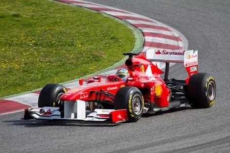 BARCELONA, SPAIN - FEBRUARY 18, 2011: Fernando Alonso of Ferrari team driving his F1 car during Formula One Teams Test Days at Catalunya circuit. Stock Photo - 11482036