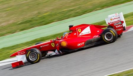 ferrari: BARCELONA, SPAIN - FEBRUARY 18, 2011: Fernando Alonso of Ferrari team driving his F1 car during Formula One Teams Test Days at Catalunya circuit.