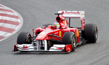 ferrari: BARCELONA, SPAIN - FEBRUARY 18, 2011: Fernando Alonso of Ferrari team driving his F1 car during Formula One Teams Test Days at Catalunya circuit.