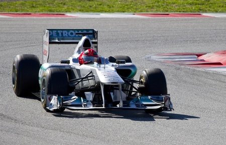 michael schumacher: BARCELONA, SPAIN - FEBRUARY 18, 2011: Michael Schumacher of Mercedes team driving his F1 car during Formula One Teams Test Days at Catalunya circuit.
