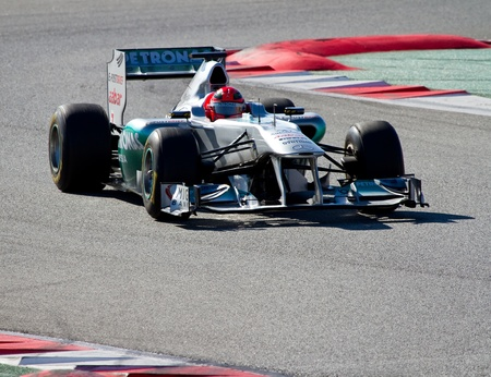 BARCELONA, SPAIN - FEBRUARY 18, 2011: Michael Schumacher of Mercedes team driving his F1 car during Formula One Teams Test Days at Catalunya circuit.