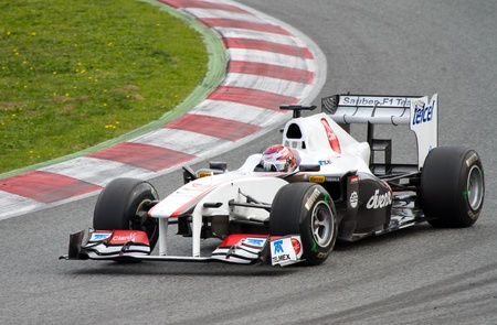 BARCELONA, SPAIN - FEBRUARY 18, 2011: Kamui Kobayashi of Sauber team driving his F1 car during Formula One Teams Test Days at Catalunya circuit.