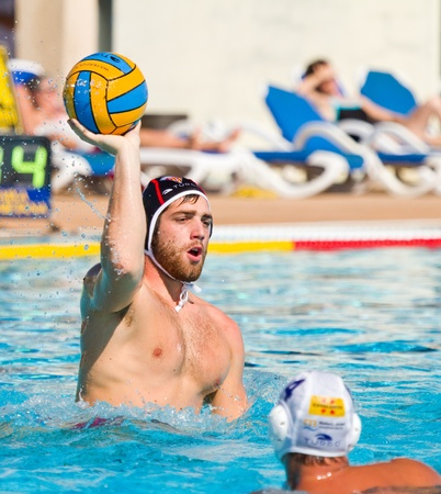 polo sport: MATARO, SPAIN - OCTOBER 12, 2011: Unidentified water polo player in action during the Spanish League match between Mataro and CN Terrassa, final score 7-6, in Mataro, Barcelona, Spain. Editorial