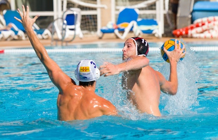MATARO, SPAIN - OCTOBER 12, 2011: Unidentified water polo player in action during the Spanish League match between Mataro and CN Terrassa, final score 7-6, in Mataro, Barcelona, Spain. 에디토리얼
