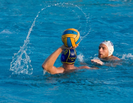 MATARO, SPAIN - OCTOBER 16, 2010: Unidentified players in action during water polo Quadis Tournament match between CN Mataro and CN Catalunya on October 16, 2010 in Mataro, Spain.