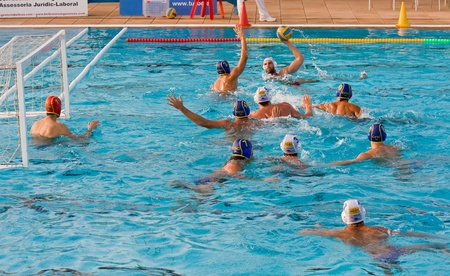 waterpolo: MATARO, SPAIN - OCTOBER 16, 2010: Unidentified players in action during water polo Quadis Tournament match between CN Mataro and CN Catalunya on October 16, 2010 in Mataro, Spain.