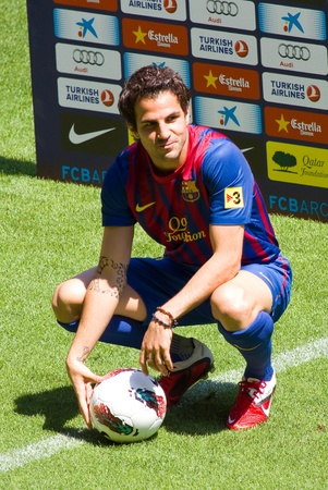 fabregas: BARCELONA - AUGUST 15, 2011: Spanish footballer Cesc Fabregas during his presentation as new FC Barcelona player in Camp Nou stadium.
