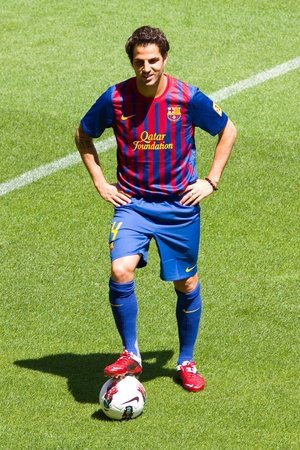 cesc: BARCELONA - AUGUST 15, 2011: Spanish footballer Cesc Fabregas during his presentation as new FC Barcelona player in Camp Nou stadium.