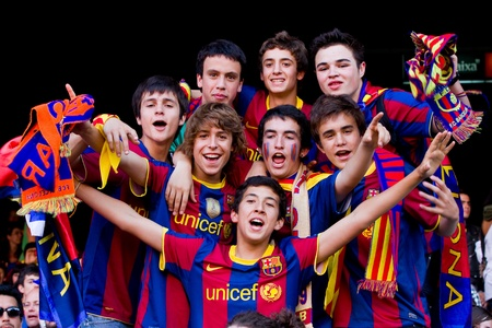 BARCELONA, SPAIN - MAY 13, 2011: Unidentified FC Barcelona supporters celebrate the Spanish League Championship victory in Camp Nou stadium. Stock Photo - 11652851