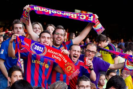 BARCELONA, SPAIN - MAY 13, 2011: Unidentified FC Barcelona supporters celebrate the Spanish League Championship victory in Camp Nou stadium. Stock Photo - 11652852