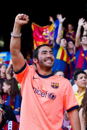 BARCELONA, SPAIN - MAY 13, 2011: Unidentified FC Barcelona supporters celebrate the Spanish League Championship victory in Camp Nou stadium. Stock Photo - 11652850
