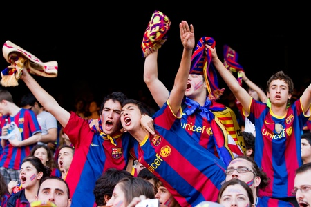 BARCELONA, SPAIN - MAY 13, 2011: Unidentified FC Barcelona supporters celebrate the Spanish League Championship victory in Camp Nou stadium. Stock Photo - 11652841