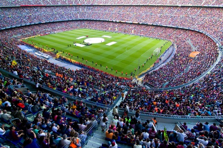 spectator: BARCELONA, SPAIN - MAY 13, 2011: Unidentified FC Barcelona supporters celebrate the Spanish League Championship victory in Camp Nou stadium.