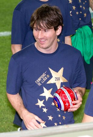 BARCELONA - MAY 13, 2011: Leo Messi celebrate the Spanish League Championship victory during a party in Camp Nou stadium.