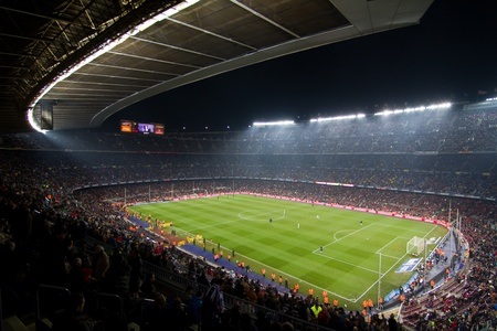 football stadium: BARCELONA, SPAIN - DECEMBER 13, 2010: Panoramic view of the Camp Nou, the stadium of Football Club Barcelona team, before the match FC Barcelona - Real Sociedad, final score 5 - 0.