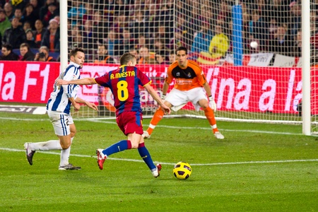 iniesta: BARCELONA, SPAIN - DECEMBER 13, 2010: Andres Iniesta (8) in action during the Spanish Soccer League match between FC Barcelona and Real Sociedad, final score 5 - 0, in Camp Nou stadium.