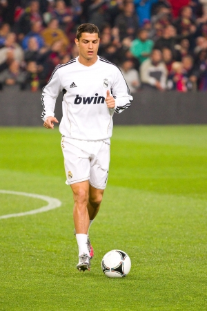 BARCELONA - JANUARY 25, 2012: Cristiano Ronaldo of Madrid in action during the Spanish Cup match between FC Barcelona and Real Madrid, final score 2 - 2, on January 25, 2012, in Camp Nou, Barcelona, Spain. 에디토리얼