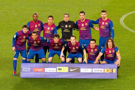 xavi: BARCELONA - JANUARY 25, 2012: FC Barcelona players lineup before the Spanish Cup match between FC Barcelona and Real Madrid, final score 2 - 2, on January 25, 2012, in Camp Nou, Barcelona, Spain.