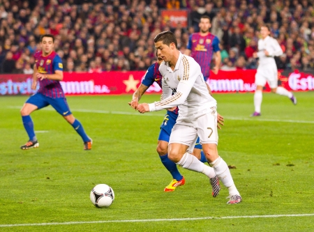 BARCELONA - JANUARY 25, 2012: Cristiano Ronaldo of Madrid in action during the Spanish Cup match between FC Barcelona and Real Madrid, final score 2 - 2, on January 25, 2012, in Camp Nou, Barcelona, Spain.
