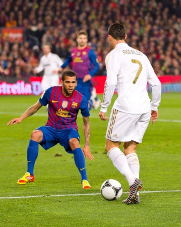 BARCELONA - JANUARY 25: Dani Alves (L) and Cristiano Ronaldo in action during the Spanish Cup match between FC Barcelona and Real Madrid, final score 2 - 2, on January 25, 2012, in Barcelona, Spain.