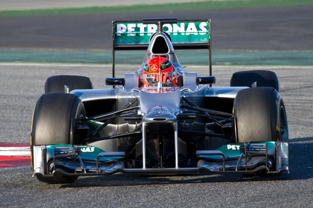 BARCELONA - FEBRUARY 21, 2012: Michael Schumacher of Mercedes F1 team races during Formula One Teams Test Days at Catalunya circuity, Barcelona, Spain. 에디토리얼