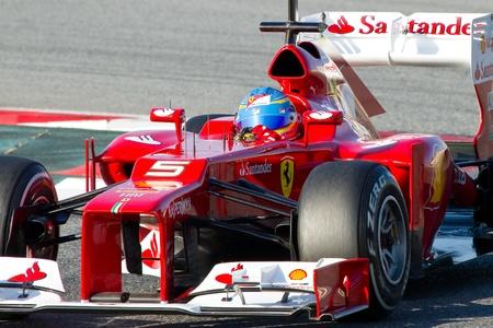 f1: BARCELONA - FEBRUARY 21, 2012: Fernando Alonso of Ferrari F1 team races during Formula One Teams Test Days at Catalunya circuity, Barcelona, Spain.