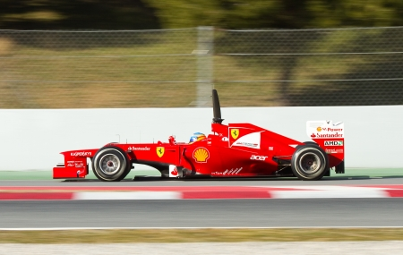 BARCELONA - FEBRUARY 21, 2012: Fernando Alonso of Ferrari F1 team races during Formula One Teams Test Days at Catalunya circuity, Barcelona, Spain.