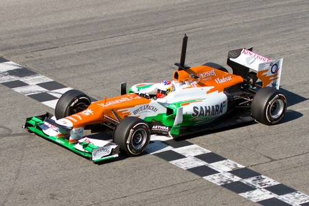 BARCELONA - FEBRUARY 21, 2012: Paul Di Resta of Force India F1 team races during Formula One Teams Test Days at Catalunya circuity, Barcelona, Spain.