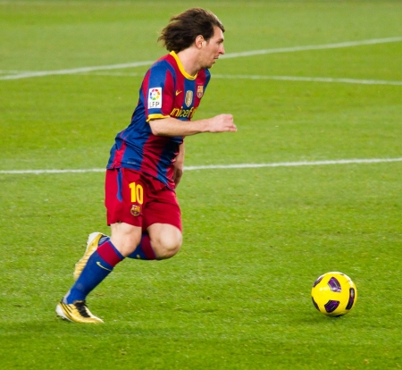 BARCELONA, SPAIN - DECEMBER 13, 2010: Lionel Messi in action during the Spanish Soccer League match between FC Barcelona and Real Sociedad, final score 5 - 0, in Camp Nou stadium. Stock Photo - 12690945