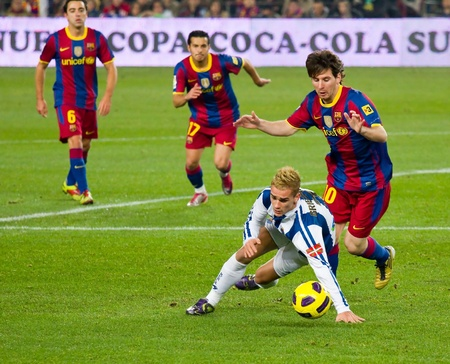BARCELONA, SPAIN - DECEMBER 13, 2010: Lionel Messi (R) in action during the Spanish Soccer League match between FC Barcelona and Real Sociedad, final score 5 - 0, in Camp Nou stadium. Stock Photo - 12690946