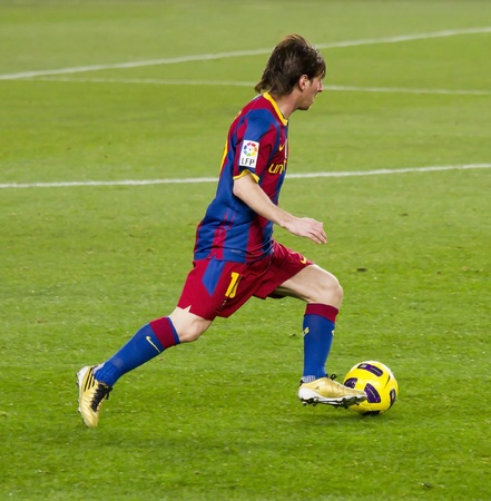 BARCELONA, SPAIN - DECEMBER 13, 2010: Lionel Messi in action during the Spanish Soccer League match between FC Barcelona and Real Sociedad, final score 5 - 0, in Camp Nou stadium. Stock Photo - 12690941