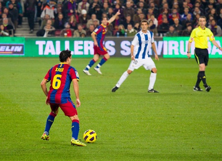 xavi: BARCELONA, SPAIN - DECEMBER 13, 2010: Xavi Hernandez (6) in action during the Spanish Soccer League match between FC Barcelona and Real Sociedad, final score 5 - 0, in Camp Nou stadium. Editorial