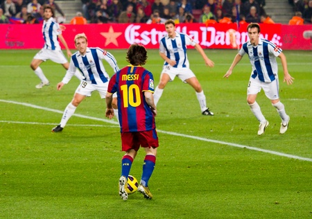 BARCELONA, SPAIN - DECEMBER 13, 2010: Lionel Messi (10) in action during the Spanish Soccer League match between FC Barcelona and Real Sociedad, final score 5 - 0, in Camp Nou stadium.