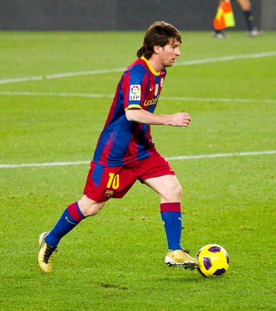 BARCELONA, SPAIN - DECEMBER 13, 2010: Lionel Messi (10) in action during the Spanish Soccer League match between FC Barcelona and Real Sociedad, final score 5 - 0, in Camp Nou stadium. Stock Photo - 12690948