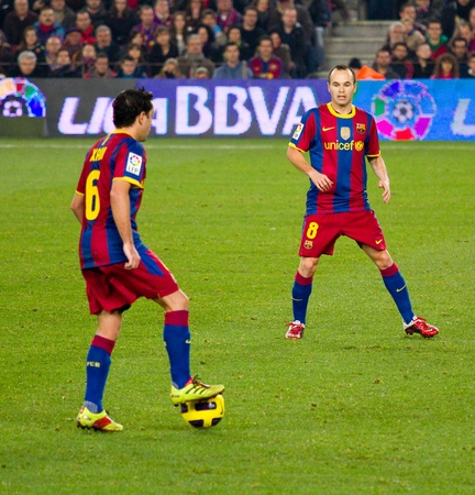 xavi: BARCELONA, SPAIN - DECEMBER 13, 2010: Xavi (L) and Andres Iniesta (R) in action during the Spanish Soccer League match between FC Barcelona and Real Sociedad, final score 5 - 0, in Camp Nou stadium.
