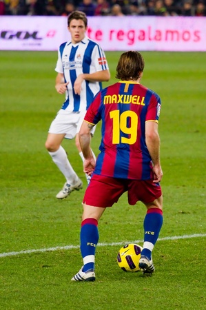 maxwell: BARCELONA, SPAIN - DECEMBER 13, 2010: Maxwell in action during the Spanish Soccer League match between FC Barcelona and Real Sociedad, final score 5 - 0, in Camp Nou stadium. Editorial