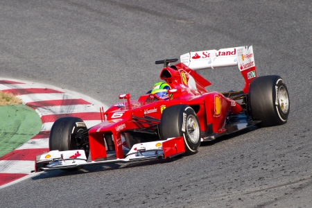 BARCELONA - FEBRUARY 24, 2012: Felipe Massa of Ferrari F1 team races during Formula One Teams Test Days at Catalunya circuity, Barcelona, Spain Stock Photo - 12778381